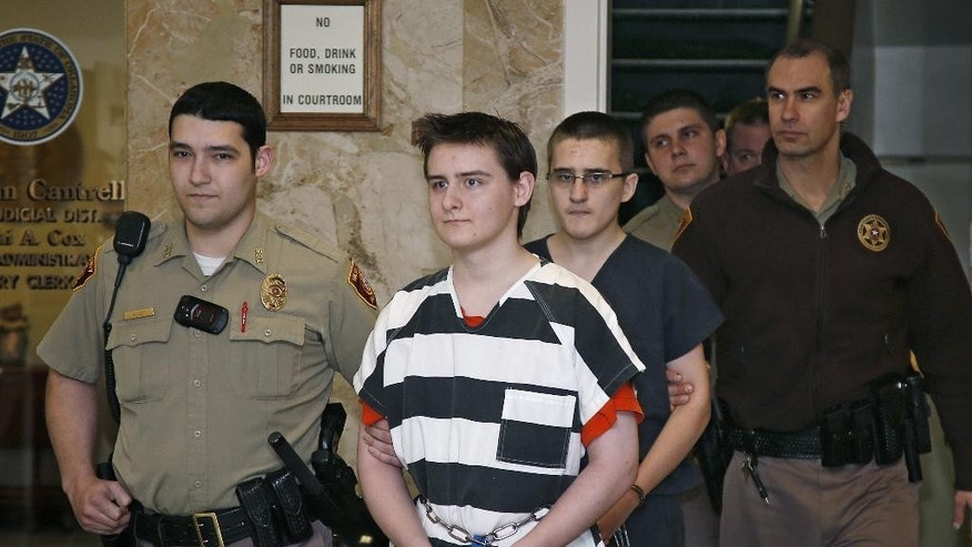 FILE- In this Tuesday, Feb. 23, 2016 file photo, Robert Bever, second from left, and Michael Bever, third from left, are escorted into a courtroom for a hearing in Tulsa, Okla. The two Oklahoma teenage brothers are charged with fatally stabbing their parents and three of their younger siblings. Robert Bever, the elder of the two, has been sentenced to life without parole after pleading guilty in the killings. (AP Photo/Sue Ogrocki, File)