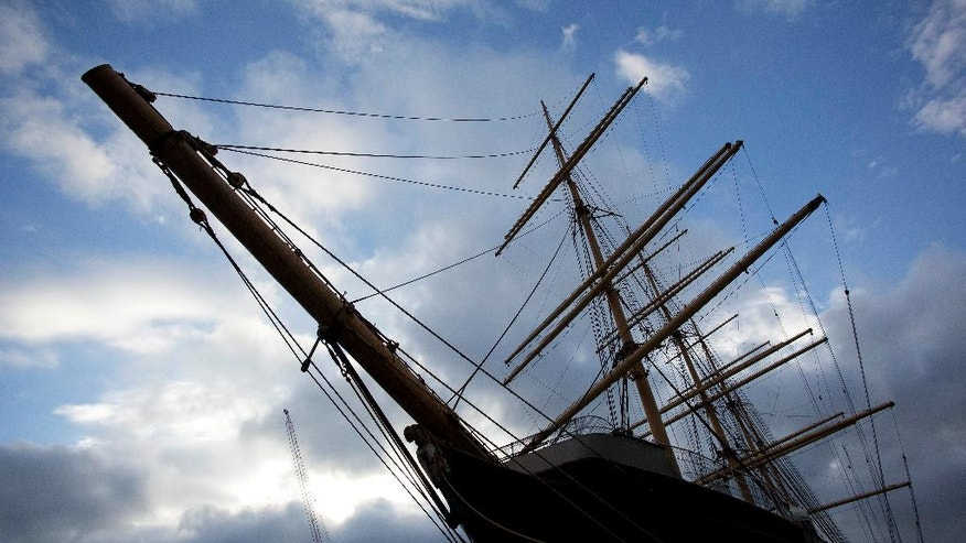 The Peking is docked at the South Street Seaport prior to starting its journey to a Staten Island dry dock, Wednesday, Sept. 7, 2016, in New York. The sailing ship that was a tourism fixture in New York City's seaport district since 1974 has left Manhattan for good Wednesday on a journey that will eventually return it to its birthplace in Hamburg, Germany. (AP Photo/Mark Lennihan)