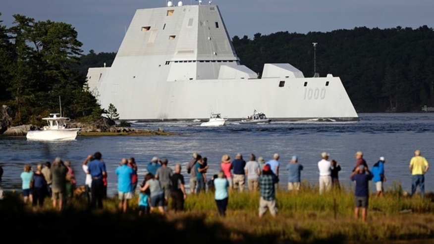 The future USS Zumwalt heads down the Kennebec River after leaving Bath Iron Works Wednesday, Sept. 7, 2016, in Bath, Maine.
