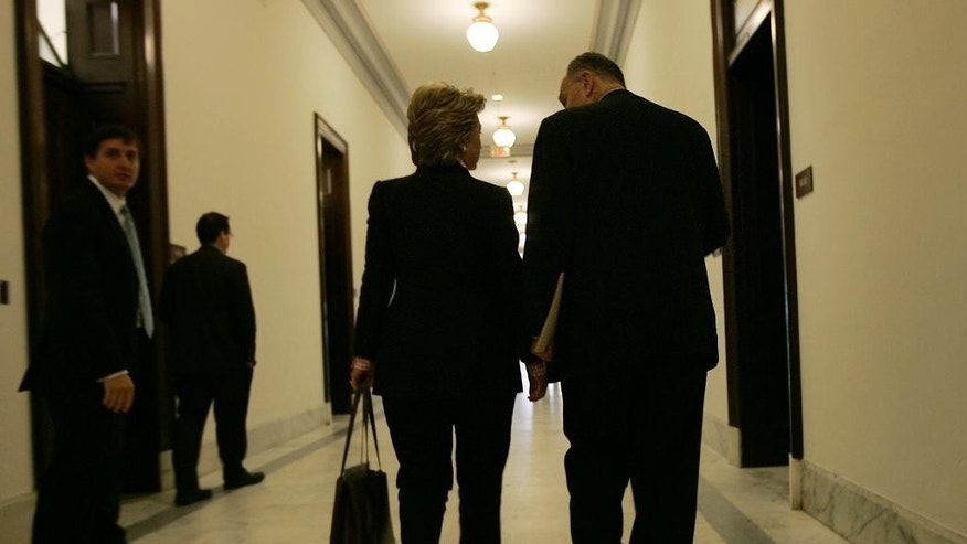 FILE - In this May 22, 2007 file photo, Democratic presidential candidate then-second-term Sen. Hillary Clinton, D-N.Y., left, walks in the hallway of the Russell Senate office building on Capitol Hill in Washington with Sen. Charles Schumer, D-N.Y. If Clinton wins the White House, Schumer is expected to be her top Democratic partner in the Senate _ with the November election also determining whether he'll be leading a majority or minority party. In either case, their relationship would quickly become one of the most important in Washington, a crucial lynchpin in Clinton's efforts to garner congressional support for her priorities.  (AP Photo/Susan Walsh, File)