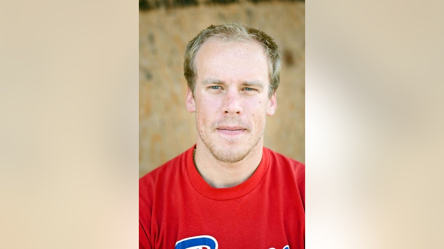 """This 2009 photo shows Kyle Dempster. Two well-known Utah climbers are missing in Pakistan where they were attempting to make a treacherous ascent up an icy mountain. Alpinists Dempster and Scott Adamson were due back at base camp on Friday, Aug. 26, 2016, after they left five days earlier to begin an ascent up the north face of a place called """"Ogre II"""" off the Choktoi Glacier in northern Pakistan, said Jonathan Thesenga of Black Diamond Equipment. Snowy and cloudy conditions are hindering rescue efforts that began Sunday, he said. (Nathan Smith/Pull Photography via AP)"""