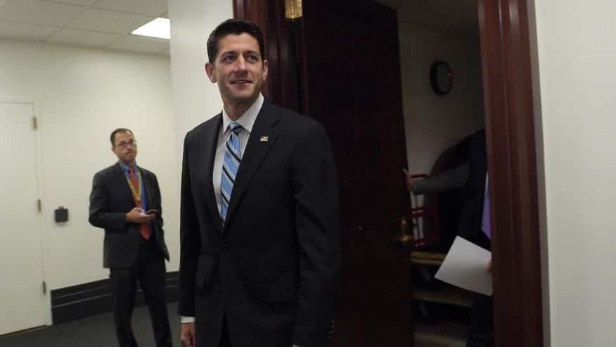 House Speaker Paul Ryan of Wis. walks to a news conference on Capitol Hill in Washington, Wednesday, Sept. 7, 2016, following a meeting with House Republicans. (AP Photo/Susan Walsh)