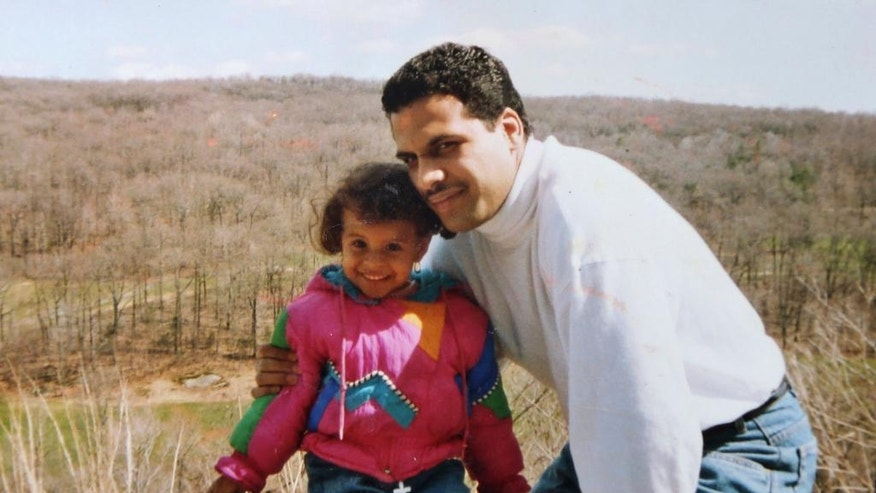 """This undated photo provided by Thea Trinidad shows her with her father, Michael Trinidad. Michael was a former high school wrestler who didn't flinch when his tomboy daughter did leaping moves off the furniture. In fact, """"he'd say, 'No, you're doing it wrong _ let me show you,'"""" says Thea, 25, who lives in Tampa, Fla. She says she feels her father's spirit every time she goes into the ring. """"This one's for you, Dad,"""" she tells herself. """"Protect me out there."""" (Courtesy of Thea Trinidad via AP)"""