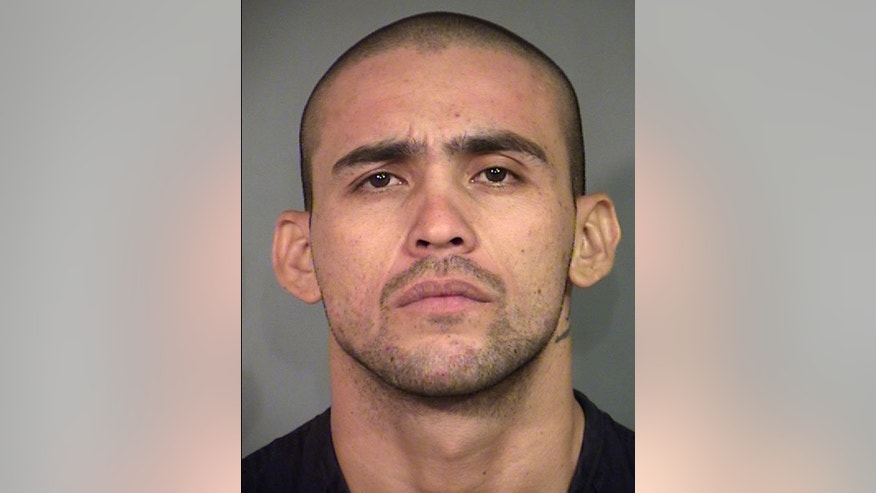 This undated jail booking photo provided by the North Las Vegas Police Department shows Alonso Perez, 25. A police chief showed video Wednesday, Sept. 7, 2016, of the Nevada homicide suspect breaking a set of handcuffs before climbing onto a chair to remove a ceiling tile and escape from a North Las Vegas police interview room last Friday. Perez was re-arrested late Tuesday, when police and FBI agents arrived at an apartment not far from where the stolen truck he abandoned earlier had been found, the police chief said. (The North Las Vegas Police Department via AP)