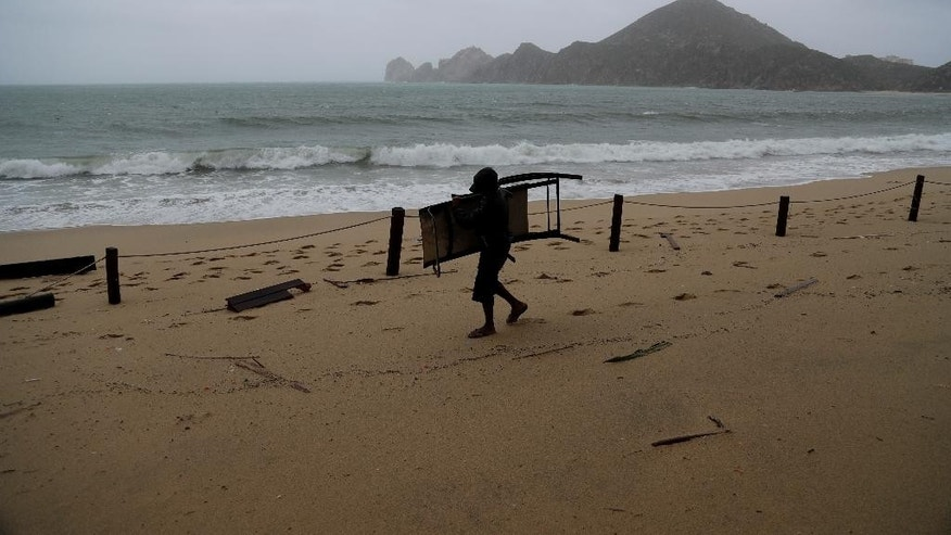 A man recovers belongings after the passing of Hurricane Newton in Cabo San Lucas.