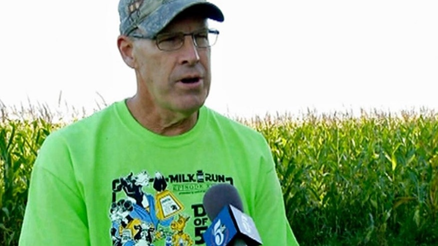 In this Sept. 3, 2016 frame grab provided by KSTP-TV, Dan Rassier talks with a reporter at his farm near St. Joseph, Minn. Rassier, who lived under a cloud of suspicion since 11-year-old Jacob Wetterling was kidnapped from the end of his driveway in 1989, can finally breathe easier now that another man has confessed to the boy's abduction and murder. Rassier was questioned about Jacob's abduction several times over the years and was subjected to lie detector tests and hypnosis. In 2010, authorities got search warrants to dig up his farm after they said he made suspicious statements to investigators and to Jacob's mother. He was then named a person of interest. On Sept. 6, 2016, Danny Heinrich confessed to the killing. (Cory Kampschroer/KSTP-TV via AP)