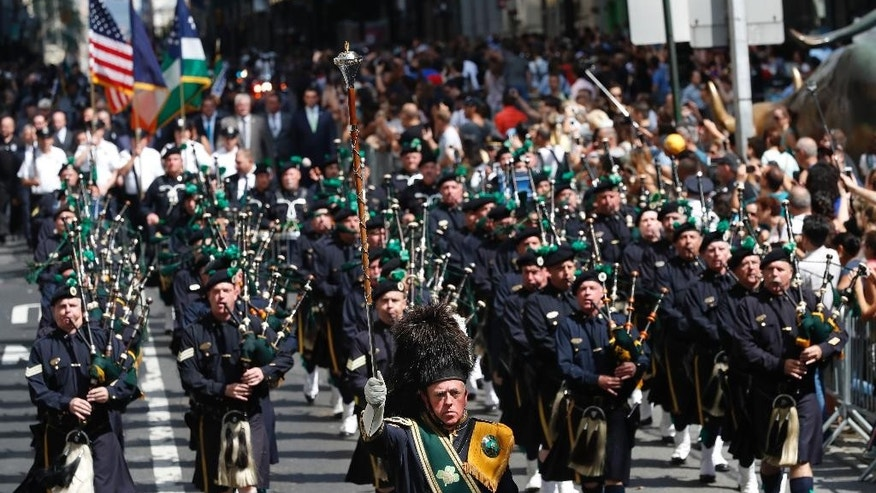Bagpipers march down Broadway during the NYPD Emerald Society Pipes & Drums memorial procession, Friday, Sept. 9, 2016, in New York. (AP Photo/Mary Altaffer)