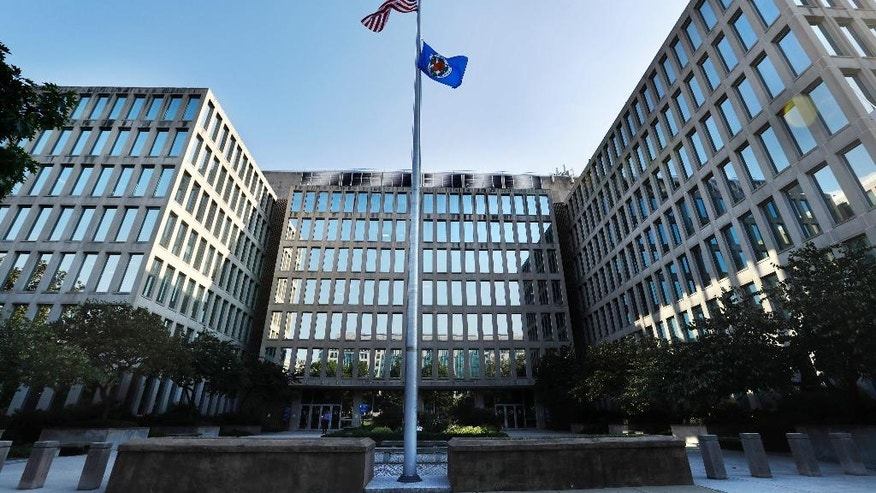 The U.S. Office of Personnel Management is photographed Tuesday, Sept. 6, 2016, in Washington. It was time to purge the hacker from the U.S. government's computers. After secretly monitoring the hacker's online movements for months, officials worried he was getting too close to critical information and devised a plan to expel him. Trouble was, with all their attention focused in that case, they missed the other hacker entirely. A new congressional report provides previously undisclosed details and a behind-the-scenes chronology of one of the worst-ever cyberattacks on the United States, laying out missed opportunities before the break-in at the OPM exposed security clearances, background checks and fingerprint records. (AP Photo/Jacquelyn Martin)