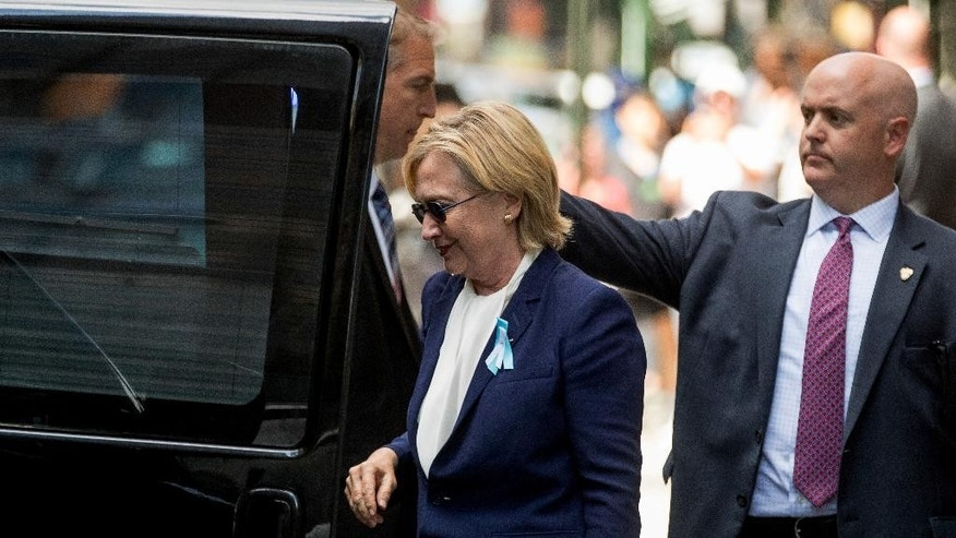 "Democratic presidential candidate Hillary Clinton gets into a van as she leaves an apartment building Sunday, Sept. 11, 2016, in New York. Clinton's campaign said the Democratic presidential nominee left the 9/11 anniversary ceremony in New York early after feeling ""overheated."" (AP Photo/Andrew Harnik)"