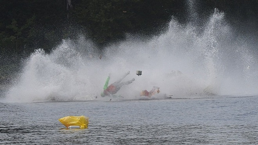 One on the racers goes airborne during a fatal crash Saturday, Sept. 10, 2016, during the Bill Giles Memorial Regatta on Watson Pond in Taunton, Mass.