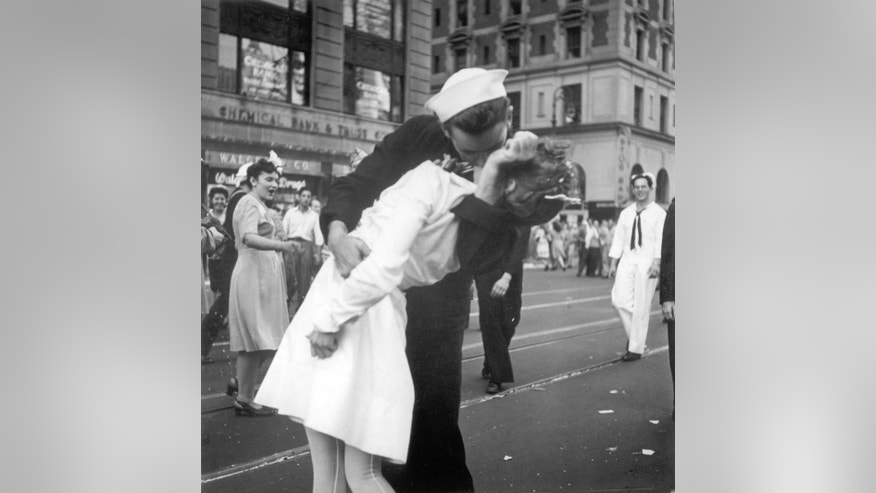 FILE - In this Aug. 14, 1945 file photo provided by the U.S. Navy, a sailor and a nurse kiss passionately in Manhattan's Times Square, as New York City celebrates the end of World War II. The woman who was kissed by an ecstatic sailor in Times Square celebrating the end of World War II has died at the age of 92. Greta Zimmer Friedman's son says his mother died Thursday, Sept. 8, 2016, at a hospital in Richmond, Virginia. She died from complications of old age, he said. (AP Photo/U.S. Navy/Victor Jorgensen, File)