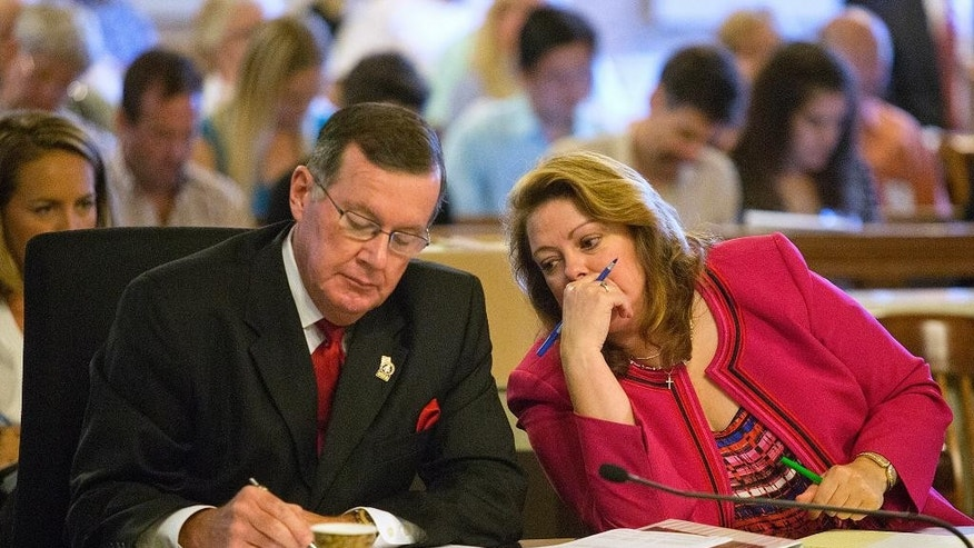 """Onondaga District Attorney William Fitzpatrick, left, and St. Lawrence County District Attorney Mary Rain talk during the trial of Oral """"Nick"""" Hillary at the St. Lawrence County Courthouse in Canton, N.Y., on Monday, Sept. 12, 2016. (Jason Hunter, Watertown Daily Times via AP, Pool)"""