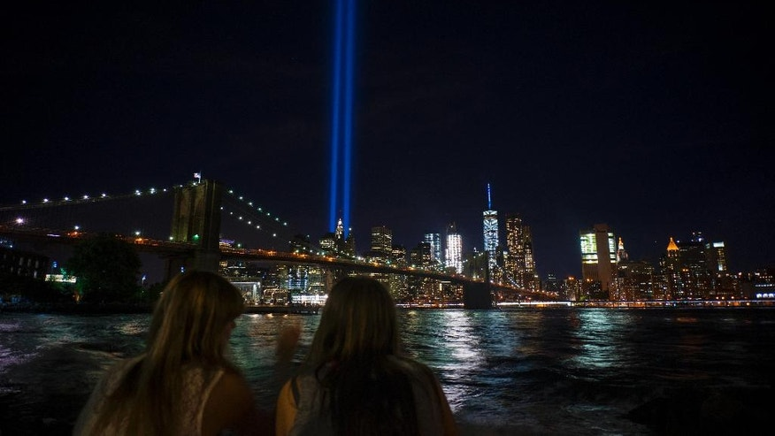 The Tribute in Light, viewed from the Brooklyn borough of New York, rises above the lower Manhattan skyline, Sunday, Sept. 11, 2016, in New York, the fifteenth anniversary of the terrorist attacks of Sept. 11, 2001 on the United States. (AP Photo/Craig Ruttle)