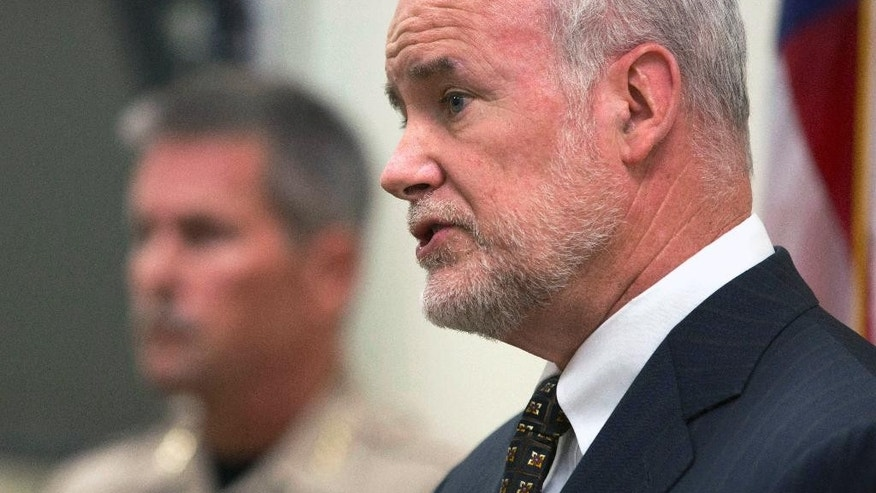 Yuba County District Attorney Patrick McGrath, discusses the arrests made related to the 1973 killings of two California girls, at a news conference, Tuesday, Sept. 13, 2016, in Marysville, Calif. Larry Don Patterson, 65, of Oklahoma, and William Lloyd Harbour, 65, of Olivehurst, Calif., were taken into custody, Tuesday, as suspects in the slayings of Valerie Janice Lane, 12, and Doris Karen Derryberry, 13, in Yuba County. At left, is Yuba County Sheriff Steven Durfor. (AP Photo/Rich Pedroncelli)