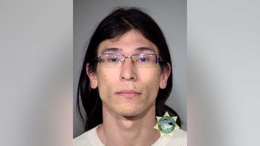 FILE--This undated photo provided by the Multnomah County Sheriff's office shows David Fry. Fry and six others are set to go on trial 9 months after the armed occupation of a wildlife refuge in Oregon. Government prosecutors are expected to begin opening statements Tuesday, Sept. 13, 2016, at the federal courthouse in Portland, Ore. (Multnomah County Sheriff's Office via AP, file)