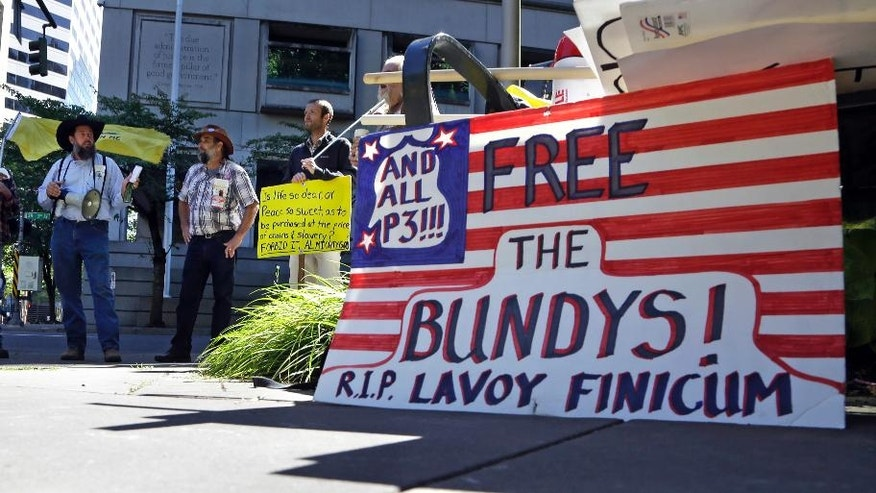 Protestors gather outside the federal courthouse in Portland, Ore., Tuesday, Sept. 13, 2016. The trial of The Bundy brothers, Ammon and Ryan, and five others are on trial nine months after the armed occupation of a wildlife refuge in Oregon as government prosecutors begin opening statements today in Portland.(AP Photo/Don Ryan)