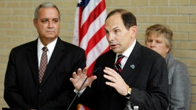 FILE - In this Oct. 1, 2014 file photo, Veterans Affairs Secretary Robert McDonald, center, accompanied by House Veterans Affairs Committee Chairman Rep. Jeff Miller, left, R-Fla., left, and Kathleen Fogarty, Director of the James A. Haley Medical Center, speaks at the James A. Haley Medical Center in Tampa, Fla. The Republican-led House is moving ahead on a bill aimed at making it easier for the Department of Veterans Affairs to fire employees for misconduct or poor performance, a source of ongoing tension with the Obama administration.  (AP Photo/Chris O'Meara, File)