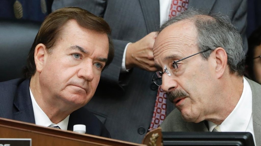 House Foreign Affairs Committee Chairman Rep. Ed Royce, R-Calif., left, listens to the committee's ranking member Rep. Eliot Engel, D-N.Y., on Capitol Hill in Washington, Wednesday, Sept. 14, 2016, during the committee's hearing on Iran. The committee approved legislation to prohibit the U.S. from making cash payments to Iran and requires that any future settlements with Tehran be conducted openly.  (AP Photo/Jacquelyn Martin)