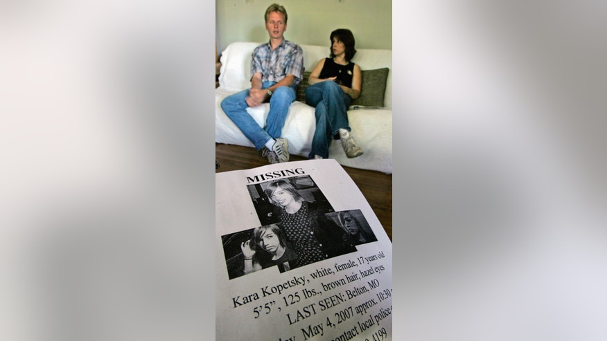 FILE - In this June 8, 2007 file photo, Jim and Rhonda Beckford talk about their their daughter, Kara Kopetsky, who was 17 when she disappeared in May 2007 in their hometown of Belton, Mo. Court records obtained Monday, Sept. 12, 2016, show that Kylr Yust, who is facing charges in the burning of a vehicle belonging to a 21-year-old Missouri woman who has been missing since Sept. 8, 2016, was the subject of a protection order more than nine years ago by his then-girlfriend Kopetsky, who accused him of kidnapping and abuse. Kopetsky remains missing.  (AP Photo/Charlie Riedel, File)
