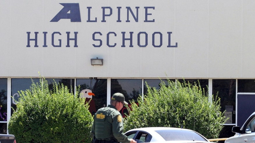 Sept. 8, 2016: A United States Border Patrol officer patrols the perimeter at Alpine High School after a shooting in Alpine, Texas.