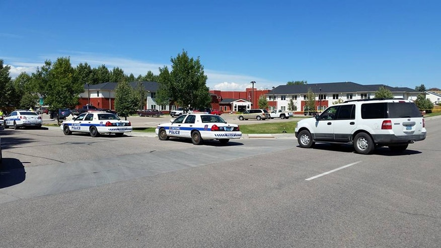 Sept. 14, 2016: Police surround the Heritage Court senior living apartment complex in Cheyenne, Wyo. after a shooting