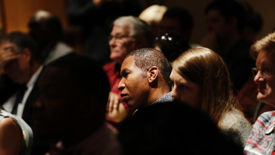 Audience members listen as former President Jimmy Carter speaks at a Baptist conference in Atlanta, Thursday, Sept. 15, 2016. Carter says the United States is experiencing 'a resurgence of racism' and called on Baptist faith leaders to lead change in their communities. The former U.S. president spoke Thursday at a summit hosted by the New Baptist Covenant, an effort he formed in 2007 to unite Baptists. Carter says some white Americans stay quiet when they see racism or discrimination, fearful of losing a 'position of privilege' in society. (AP Photo/David Goldman)