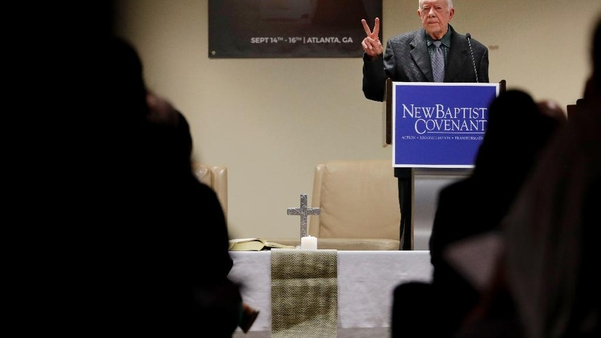 Former President Jimmy Carter speaks at a Baptist conference in Atlanta, Thursday, Sept. 15, 2016. Carter says the United States is experiencing 'a resurgence of racism' and called on Baptist faith leaders to lead change in their communities. The former U.S. president spoke Thursday at a summit hosted by the New Baptist Covenant, an effort he formed in 2007 to unite Baptists. Carter says some white Americans stay quiet when they see racism or discrimination, fearful of losing a 'position of privilege' in society. (AP Photo/David Goldman)