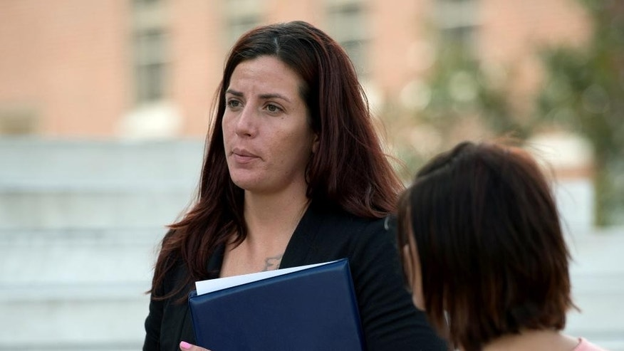 Nicole Dudley pauses outside the Kent County Courthouse, in Dover, Del., after the sentencing hearing for Justin Corbett, Thursday, Sept. 15, 2016. Corbett, a former airman at Dover Air Force Base was sentenced to 18 months of probation in the death of a 21-month-old boy who was left in his care while Dudley, the boy's mother, was deployed overseas.  (Jason Minto/The Wilmington News-Journal via AP)