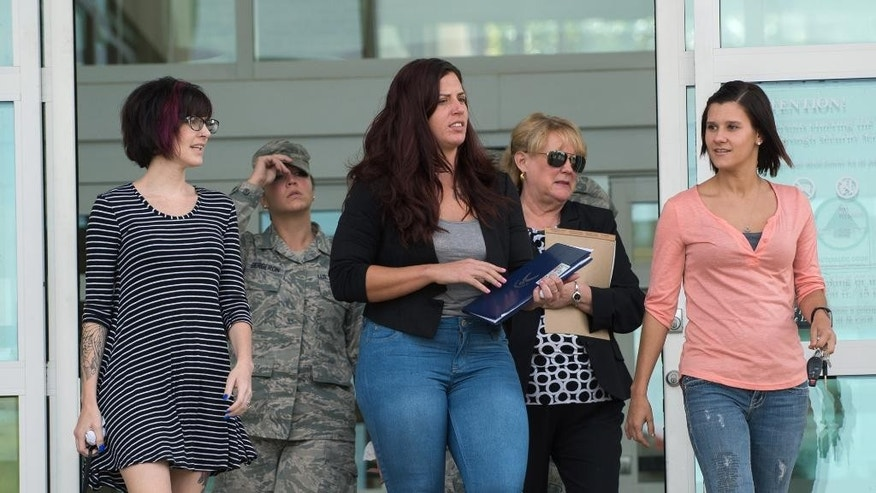 Nicole Dudley, center, walks out of the Kent County Courthouse after the sentencing hearing for Justin Corbett, Thursday, Sept. 15, 2016. Corbett, a former airman at Dover Air Force Base was sentenced to 18 months of probation in the death of a 21-month-old boy who was left in his care while Dudley, the boy's mother, was deployed overseas.  (Jason Minto/The Wilmington News-Journal via AP)
