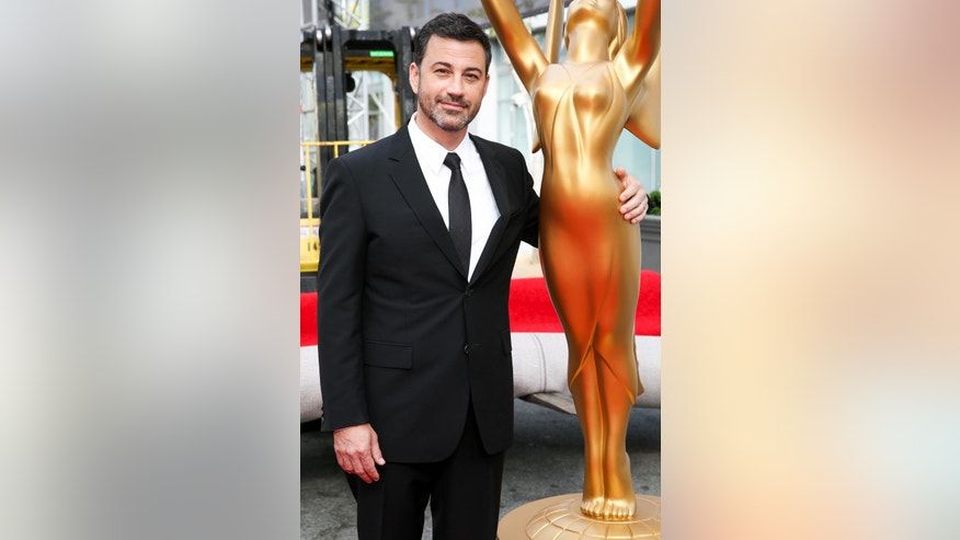Host Jimmy Kimmel poses for a photo with an Emmy statue at the Primetime Emmy Awards Press Preview Day at the Microsoft Theater on Wednesday, Sept. 14, 2016, in Los Angeles. (Photo by Rich Fury/Invision/AP)