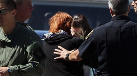 Two women grieve after hearing news that a shooting at Heritage Court Apartments Wednesday, Sept. 14, 2016 in northeast Cheyenne, Wyo.  A 77-year-old man living at a senior citizen apartment complex shot three people at the complex Wednesday, killing one of them, and then killed himself nearby as officers closed in on him, police said. (Blaine McCartney/The Wyoming Tribune Eagle via AP)