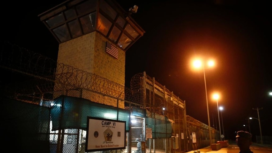 FILE - In this Nov. 20, 2013 file photo, reviewed by the U.S. military, the entrance to Camp VI detention facility is guarded at Guantanamo Bay Naval Base, Cuba. The House on Thursday, Sept. 15, 2016, backed election-year legislation that would temporarily halt the transfer of more terror suspects from the U.S. naval prison at Guantanamo Bay, Cuba. (AP Photo/Charles Dharapak, File)