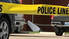 A man killed by a shooter at a senior citizen apartment is covered by a sheet on a stretcher Wednesday, Sept. 14, 2016 in Cheyenne, Wyo. A 77-year-old man living at the senior citizen apartment complex shot three people at the complex, killing one of them, and then killed himself nearby as officers closed in on him. (AP Photo/Mead Gruver)