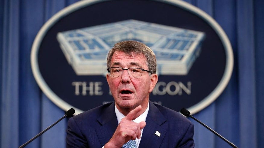 FILE - In this June 30, 2016 file photo, Defense Secretary Ash Carter speaks during a news conference at the Pentagon. The U.S. military will have to shift surveillance aircraft from other regions and increase the number of intelligence analysts to coordinate attacks with Russia under the Syria cease-fire deal partly in order to target militants the U.S. has largely spared, senior officials say.  (AP Photo/Alex Brandon, File)