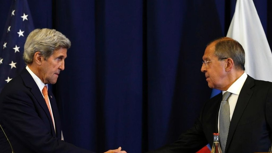 FILE - In this Sept. 9, 2016 file photo, Secretary of State John Kerry, left, and Russian Foreign Minister Sergei Lavrov shakes hands at the conclusion of a news conference following their meeting to discuss the crisis in Syria, in Geneva, Switzerland. The U.S. military will have to shift surveillance aircraft from other regions and increase the number of intelligence analysts to coordinate attacks with Russia under the Syria cease-fire deal partly in order to target militants the U.S. has largely spared, senior officials say.  (Kevin Lamarque/Pool Photo via AP, File)
