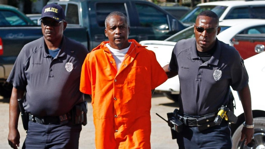 Rodney Earl Sanders, of Kosciusko, Miss., says nothing as he enters the Durant Municipal Building for a probable cause hearing in municipal court, Friday, Sept. 16, 2016, in Durant, Miss. Sanders is charged in the deaths of two 68-year-old nuns, Sister Margaret Held and Sister Paula Merrill, who were killed Aug. 25 in their Durant, home. The nuns, both nurse practitioners, worked in a Lexington medical clinic. (AP Photo/Rogelio V. Solis)