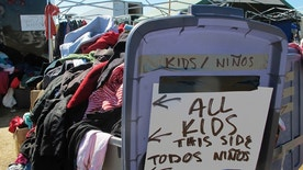 In this Wednesday, Sept. 14, 2016, photo, piles of donated clothes for people protesting the construction of the Dakota Access Pipeline are shown at an encampment near the Standing Rock Sioux Reservation in southern North Dakota. Thousands of people have joined the tribe in recent weeks in its fight against the four-state, $3.8 billion pipeline. (AP Photo/James MacPherson).