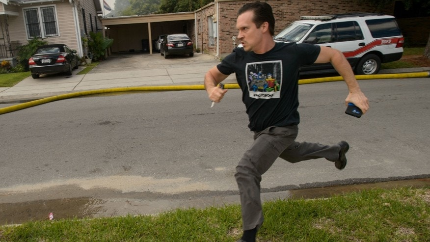 Sept. 15, 2016: Writer and actor Gideon Hodge runs towards his burning home in New Orleans, La.