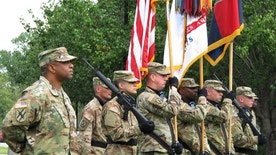 Col. Reginald Neal, far left, commander of the 48th Infantry Brigade of the Georgia National Guard, stands with an Army color guard Friday, Sept. 16, 2016 during a ceremony at Fort Stewart, Ga., to mark the brigade's new alignment with the Army's 3rd Infantry Division. The Army is pairing a dozen National Guard and Reserve units nationwide with active-duty commands, hoping to improve the combat readiness of citizen-soldiers. (AP Photo/Russ Bynum)
