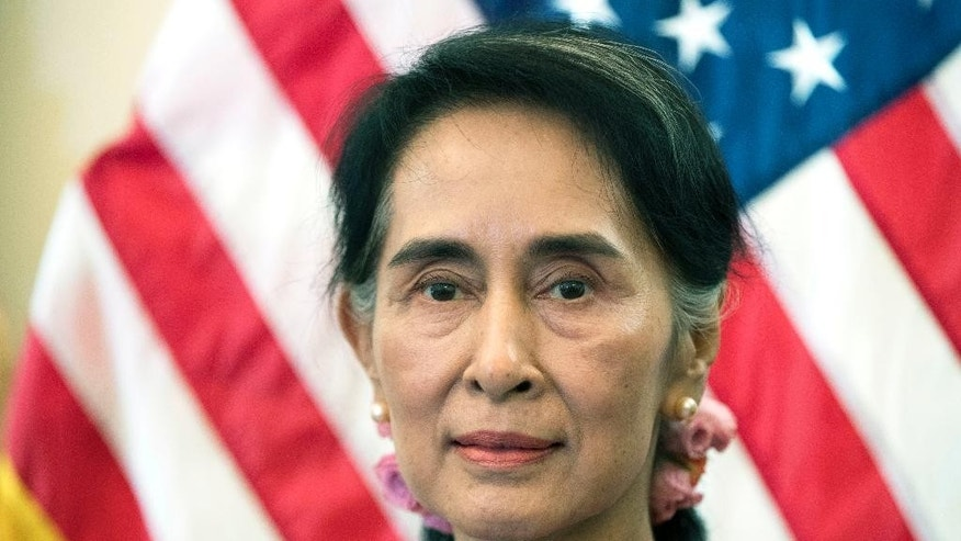 FILE - In this Sept. 15, 2016 file photo, Myanmar leader Aung San Suu Kyi, is attends a meeting on Capitol Hill in Washington. The 1991 Nobel Peace Prize laureate will receive the Harvard Foundation's 2016 Harvard Peter J. Gomes Humanitarian Award on Saturday, Sept. 17 in Cambridge, Mass. (AP Photo/Manuel Balce Ceneta, File)