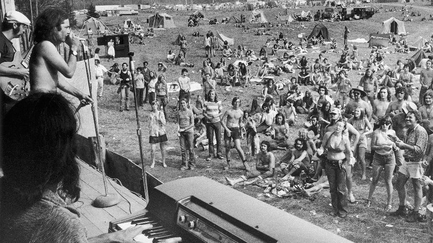 FILE - In this Sept. 1, 1973 file photo, a rock band plays before concert goers on the opening day of a rock festival in Holland, Vt., that attracted a thousands of young people over the three-day Labor Day weekend. The Vermont Historical Society's exhibit 'Freaks, Radicals & Hippies: Counterculture in the 1970s in Vermont' opens at the Vermont History Center in Barre, Vt. on Sept. 24, 2016. The exhibit will showcase how the state became a hotbed for the counterculture as the influx of young people had a lasting influence on the state's politics, agriculture, food and offbeat culture. (AP Photo, File)