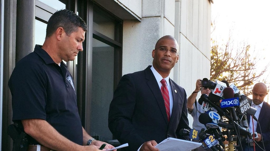 Francis Larkin, left, chief of the Seaside Park Police Department joins Brad Cohen, the acting special agent in charge of the FBI's field office in Newark, N.J., at a news conference in front of the Seaside Park Police Department, Saturday, Sept. 17, 2016 in Seaside Park, N.J. Authorities said a pipe bomb exploded in the New Jersey shore town Saturday, shortly before thousands of runners were to participate in a charity race to benefit Marines and sailors. (AP Photo/Michael Blasamo)