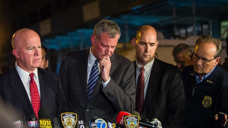 Mayor bill de blasio center and nypd chief of department james o