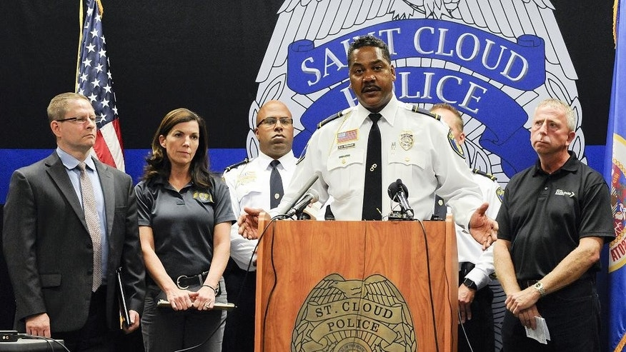 St. Cloud, Minn., Police Chief William Blair Anderson and other officials hold a press conference Sunday, Sept. 18, 2016, giving updated information on the Crossroads Center incident at the St. Cloud Police Department. A man in a private security uniform stabbed nine people at a Minnesota shopping mall Saturday, reportedly asking one victim if they were Muslim before an off-duty police officer shot and killed him in an attack the Islamic State group claimed as its own.  (Jason Wachter/St. Cloud Times via AP)