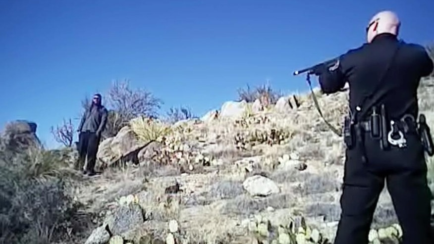 FILE - This image made from a March 16, 2014 video shows James Boyd, 38, left, during a standoff with officers in the Sandia foothills in Albuquerque, N.M., before police fatally shot him. The shooting of Boyd, who suffered from mental illness, ended a nearly five-hour standoff that involved more than a dozen officers by the time it ended. Opening statements begin Monday, Sept. 19, 2016, in the long-awaited trial of two former police officers, Keith Sandy and Dominique Perez, charged in the fatal shooting of the homeless man. (Albuquerque Police Department via AP, File )