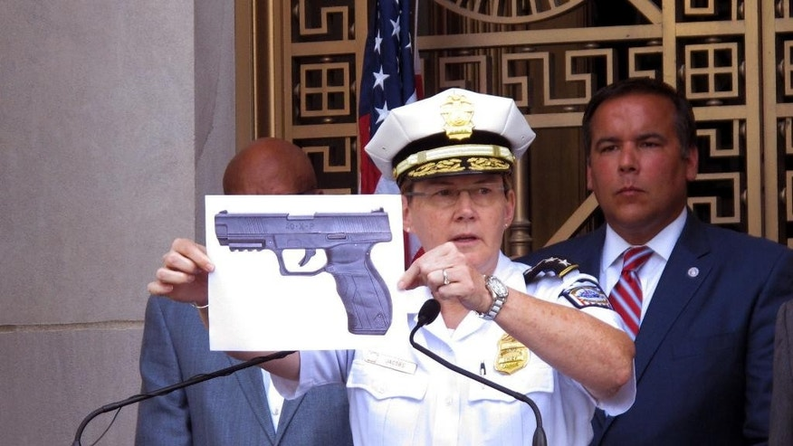 FILE - In this Thursday, Sept. 15, 2016, file photo, Columbus, Ohio, Police Chief Kim Jacobs displays a photo of the type of BB gun police say Tyre King pulled from his waistband before he was shot and killed by a police officer investigating an armed robbery report, during a news conference in Columbus, Ohio. As Ohio authorities investigate the fatal police shooting, law enforcement agencies are grappling with suspects' use of fake guns to commit real crimes. Some police departments say they've noticed an uptick in replicas. (AP Photo/Andrew Welsh-Huggins, File)