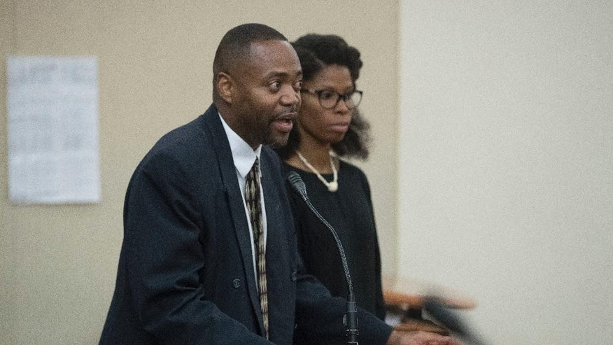 Marcus Ross, attorney for Demetrius Braxton, appears before Judge Eileen Paley on his client's behalf at Franklin County Municipal Court, Monday, Sept. 19, 2016, in Columbus, Ohio. Columbus police arrested Braxton on a robbery charge Saturday afternoon. Braxton is linked to the 13-year-old Tyre King who was shot fatally by Columbus police after an alleged robbery. Braxton had told The Columbus Dispatch that he was with King on Sept. 14 and that King had a BB gun that looked like a real firearm and wanted to rob someone for money. (AP Photo/John Minchillo)