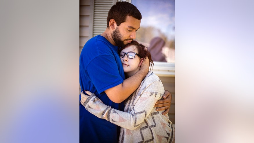 Isaiah Mordal, 22, and his girlfriend Johanna Bohnenkamp, 15, who is 9 months pregnant, outside their home in Big Lake on Monday, Sept. 19, 2016. Mordal and Bohnenkamp were both attacked by a man, suspected of being motivated by global terror, who stabbed several people late Saturday, Sept. 17 before an off-duty police officer fatally shot the attacker at the Crossroads Center mall in St. Cloud, Minn. (Leila Navidi/Star Tribune via AP)