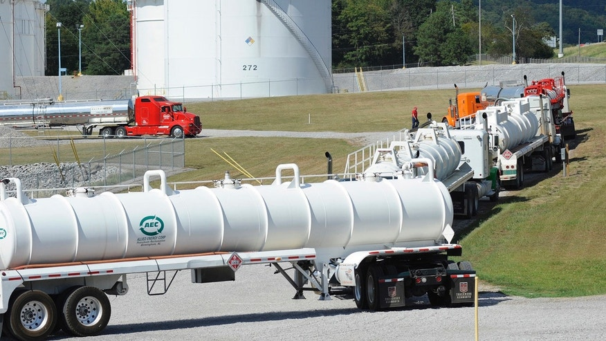 Tanker trucks line up at a Colonial Pipeline Co. facility in Pelham, Ala., near the scene of the 250,000-gallon spill.