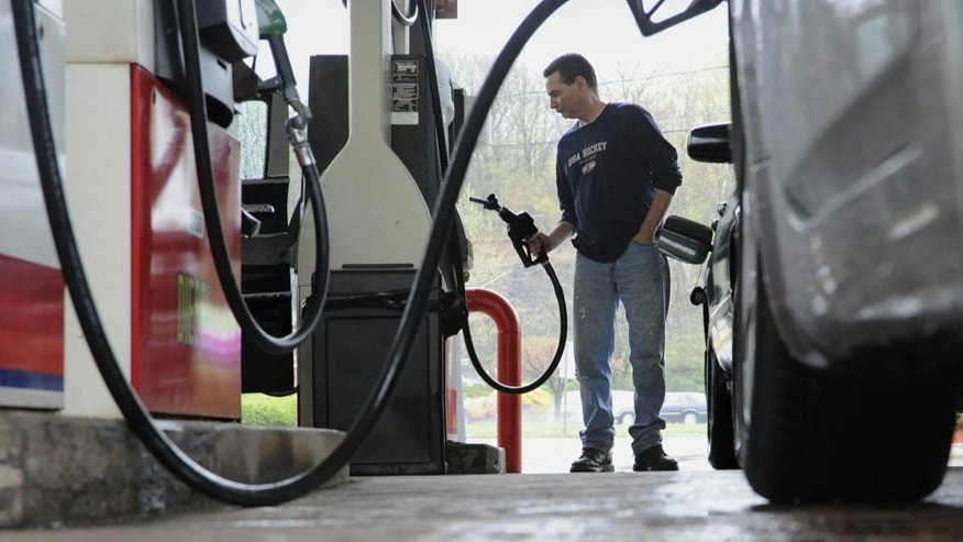 John Magel of Wetherfield pumps gas at a CITGO station in Wethersfield, Conn. (AP Photo/Jessica Hill)